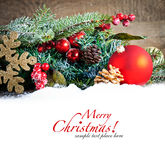 Red christmas Decoration Over Wooden Background. Royalty Free Stock Photo
