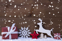 Red Christmas Decoration, Snow, Snowflakes, Reindeer And Gift Stock Photos