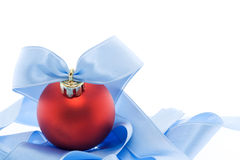 Red christmas decoration with soft blue ribbon Royalty Free Stock Images