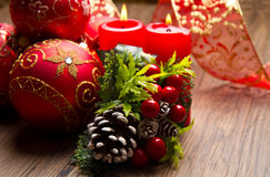 Red christmas decoration. Some red christmas decoration on wood Stock Photography