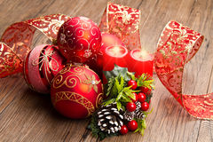 Red christmas decoration. Some red christmas decoration on wood stock image