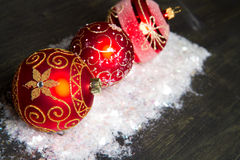 Red christmas decoration. Some red christmas decoration on wood Royalty Free Stock Photo