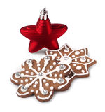 Red Christmas star and gingerbreads Stock Photos