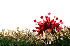 Red Christmas decoration star on gold chain & fir Stock Photos