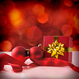 Red Christmas decoration with two balls and gift ribbon square Royalty Free Stock Image