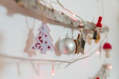 Red Christmas decoration on wood. With star and bulb in focus Royalty Free Stock Photography