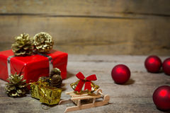 Red christmas decoration on a wooden background Royalty Free Stock Photography