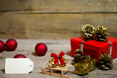 Red christmas decoration on a wooden background Royalty Free Stock Images
