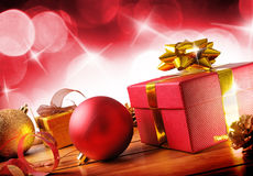 Red Christmas decoration on a wooden table horizontal composition diagonal. Red Christmas decoration on a table wooden slats. With gift boxes, balls,ribbon and royalty free stock photos