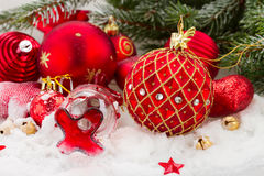 Red christmas decorations ball in snowfall Stock Photography