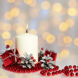 Red Christmas decorations and candles on colorful background Royalty Free Stock Images