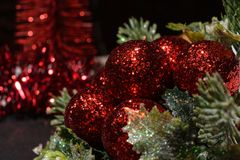 Red Christmas decorations with christmas tree branch. Christmas decorations in the background Royalty Free Stock Images