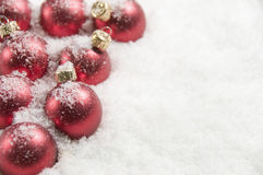 Red Christmas Decorations, Covered In Snow Stock Images