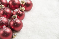 Red Christmas Decorations, Covered In Snow Royalty Free Stock Photography