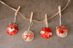 Red Christmas decorations in felt Stock Photos