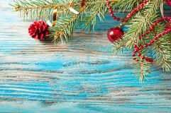 Red Christmas decorations and fir Royalty Free Stock Images