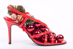 Red Christmas decorations isolated on white. Red stilettos shoes with Christmas decorations Stock Photo