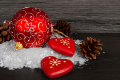 Red Christmas decorations on  snow Stock Image