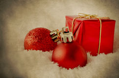 Red Christmas Decorations in Snow - Vintage Grunge Stock Photography