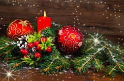 Red Christmas decorations on spruce branches Stock Photos
