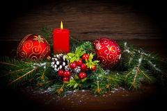 Red Christmas decorations on spruce branches Royalty Free Stock Images