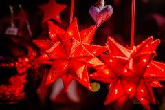 Red christmas decorations on Trentino Alto Adige, Italy Christmas market stock photo