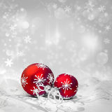 Red Christmas decorations on winter background, text space Stock Images