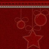Red Christmas denim background with embroidered Christmas toy balls and stars Royalty Free Stock Photos