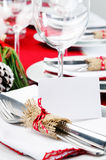 Red christmas dinner table setting Royalty Free Stock Image