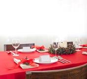Red Christmas dinner table setup Stock Photos