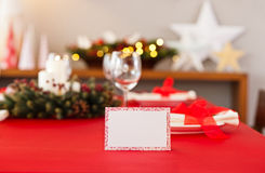 Red Christmas dinner table setup Royalty Free Stock Photography