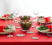 Red Christmas dinner table setup Royalty Free Stock Photo