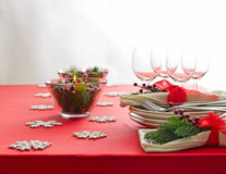 Red Christmas dinner table setup Royalty Free Stock Images