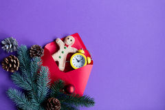 Red christmas envelope and little alarm clock Royalty Free Stock Photography