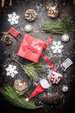Red Christmas festive gift box with winter and holiday decorations on rustic wooden background Stock Images