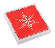 Red Christmas or festive paper napkins aka serviettes, isolated Stock Photography