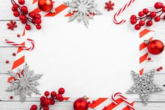 Red christmas frame with stars, snowflakes and candies stock photography