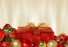 Red Christmas gift. With gold and red decorations Royalty Free Stock Image