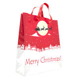 Red Christmas Gift Bag with Picture Isolated On White. Xmas Decoration. New Year Decor. Christmas Baubles. Clipping Path. Three-Di Stock Photo