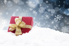 Red Christmas gift with black defocused lights. Red Christmas gift with gold ribbon on black and white defocused lights background Stock Photos
