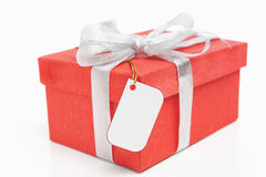 Red Christmas gift with blank tag Royalty Free Stock Images