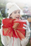 Red Christmas gift with blurred girl on background Royalty Free Stock Images