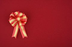 Red christmas gift bow and ribbon on Fabric for background Royalty Free Stock Photography