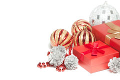 Red Christmas gift box and balls. Stock Photo