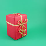 Red Christmas gift box with brown paper ribbon bow Stock Images