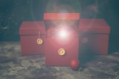 Red Christmas gift box with gold magic lights stock images