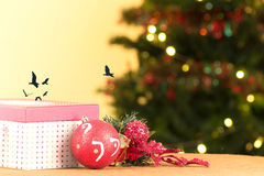 Red Christmas gift box with ornaments and tree, Stock Photos