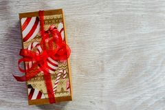 Christmas. Red Christmas  gift box  on traditional white wood background Stock Photos