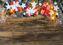 Red Christmas gift boxes on fir tree garland Stock Images