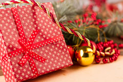 Red Christmas gift with decorations. Merry Christmas and Happy New Year Royalty Free Stock Images